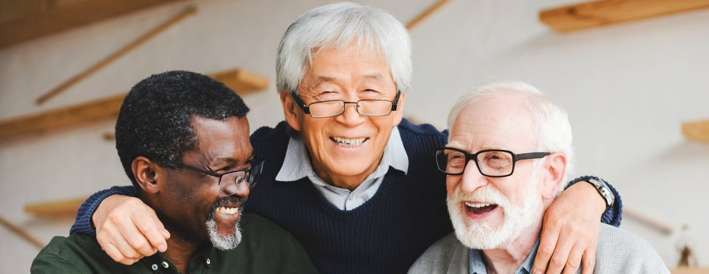 elderly men laughing together
